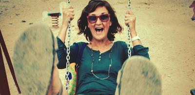 Mature_woman_on_swing