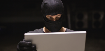 Identity_theft_with_gloves_and_laptop
