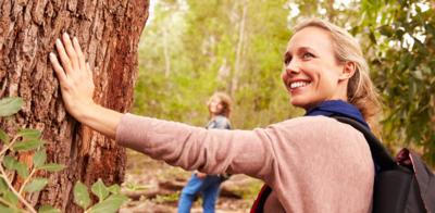Woman_hiking_near_tree