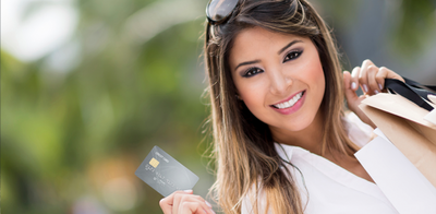 Asian woman with credit card   header photo