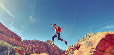 Man jumping in desert