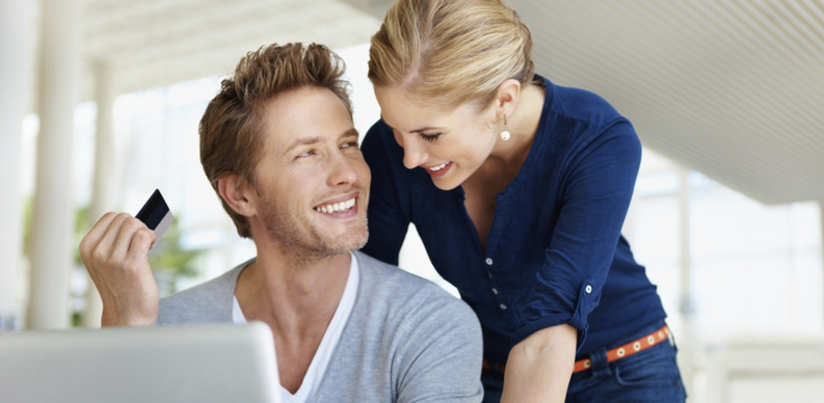 Best cards 2015   couple leaning over a computer