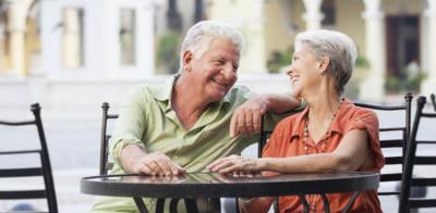 Older couple sitting cafe patio