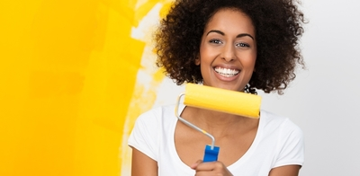Woman with yellow paint
