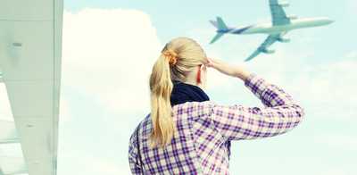 Girl looking out at airplane